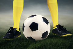 Feet player with a soccer ball Stock Images