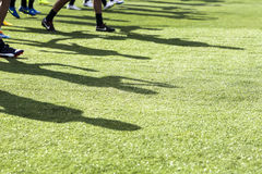 The feet of the players of Paok with their shadows during team p Stock Photography