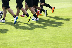 The feet of the players of Paok with their shadows during team p Royalty Free Stock Photos
