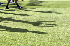 The feet of the players of Paok with their shadows during team p Stock Photo