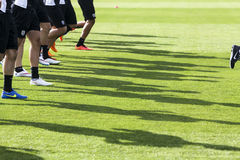 The feet of the players of Paok with their shadows during team p Stock Image