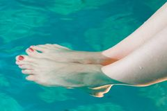 Feet in pool Stock Photography