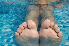 Feet in the pool  Royalty Free Stock Photo