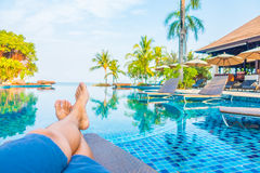 Feet with pool view royalty free stock photos