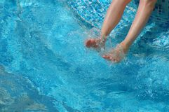 Feet in pool water Royalty Free Stock Images