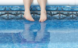 Feet in pool water Stock Photos