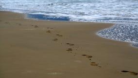 Feet prints on beautiful beach Royalty Free Stock Image