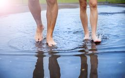 Feet in puddle Stock Photo