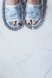Feet in quirky slippers that are also a mop Stock Photo