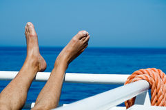 Feet on the Railing. Man put his feet on Ships Railing Royalty Free Stock Photos