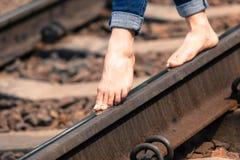 Feet on the railroad diagonal close-up Stock Photos