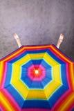 Feet & rainbow umbrella stock photo