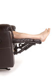 Feet on a recliner royalty free stock images