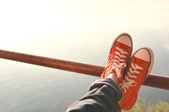 Feet red sneaker a girl in nature and relax time Stock Images