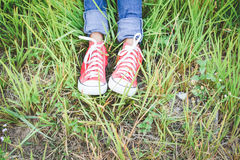 Feet red sneaker a girl in nature Stock Images