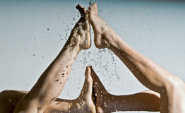 Feet refreshed by clean water. Feet refreshed by clean cold water Royalty Free Stock Photo