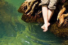 Feet relax in Crystal natural stream Royalty Free Stock Image