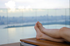 Feet relax at the pool Royalty Free Stock Images