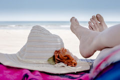 Feet resting at the beach Stock Images