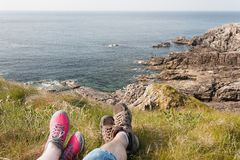 Feet Resting after a Hike, Rocky Coast, Mallin Head, Ireland. Couple`s Feet Resting after a hikeon a rocky coast, Mallin Head, Ireland stock photography