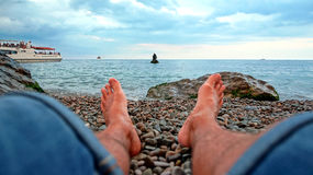 Feet resting on a sculpture of mermaids. In Miskhor Royalty Free Stock Photos