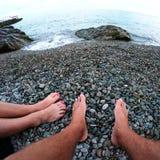 Feet resting on a sculpture of mermaids. In Miskhor Stock Photos