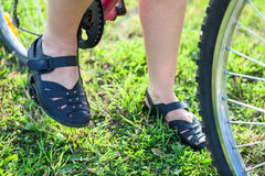 Feet of rider sitting on the bike Stock Image