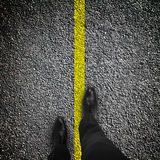 Feet are on road Stock Photos