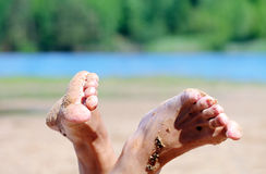 Feet on the road. In the forest Stock Image