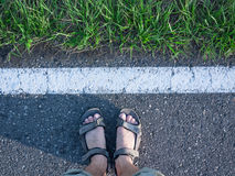 Feet at road. Travel concept Stock Photo
