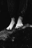 Feet on a rock Royalty Free Stock Images