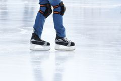 Feet rolling on skates man on the ice rink stock images