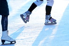 Feet rolling on skates man on the ice rink royalty free stock photo