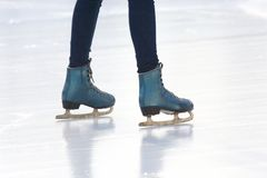 Feet rolling on skates man on the ice rink royalty free stock images