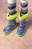 Feet in rubber boots Royalty Free Stock Photos