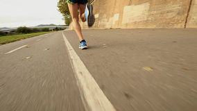 Feet of a runner. In action in slow motion stock video