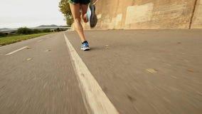 Feet of a runner stock video footage