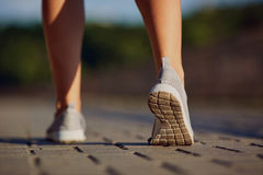 Feet runner close-up on shoe the road.  royalty free stock images