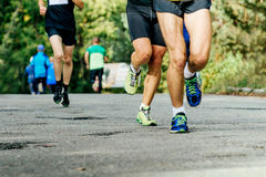 Feet runners men running. On asphalt to compete in marathon Stock Image