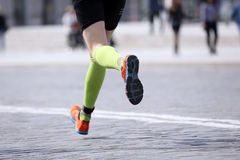 Feet running distance athlete on the stone pavement Royalty Free Stock Images