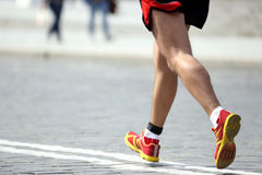 Feet running distance athlete on the stone pavement Stock Photo