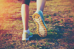 Feet running on grass Stock Photo
