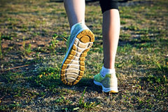 Feet running on grass. Girl jogging outside. Feet running on grass Royalty Free Stock Photo