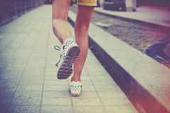 Feet running on road Stock Images