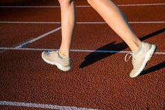 Feet running on the running track. Feet running on the red running track Royalty Free Stock Photography