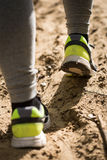 Feet in running shoes Stock Images