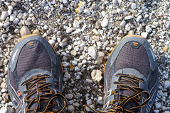 Feet in running shoes standing on stone path. Stock Photo