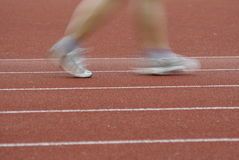 Feet running on track Royalty Free Stock Images