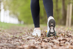 Feet of a running woman Stock Images