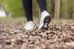 Feet of a running woman Stock Photography